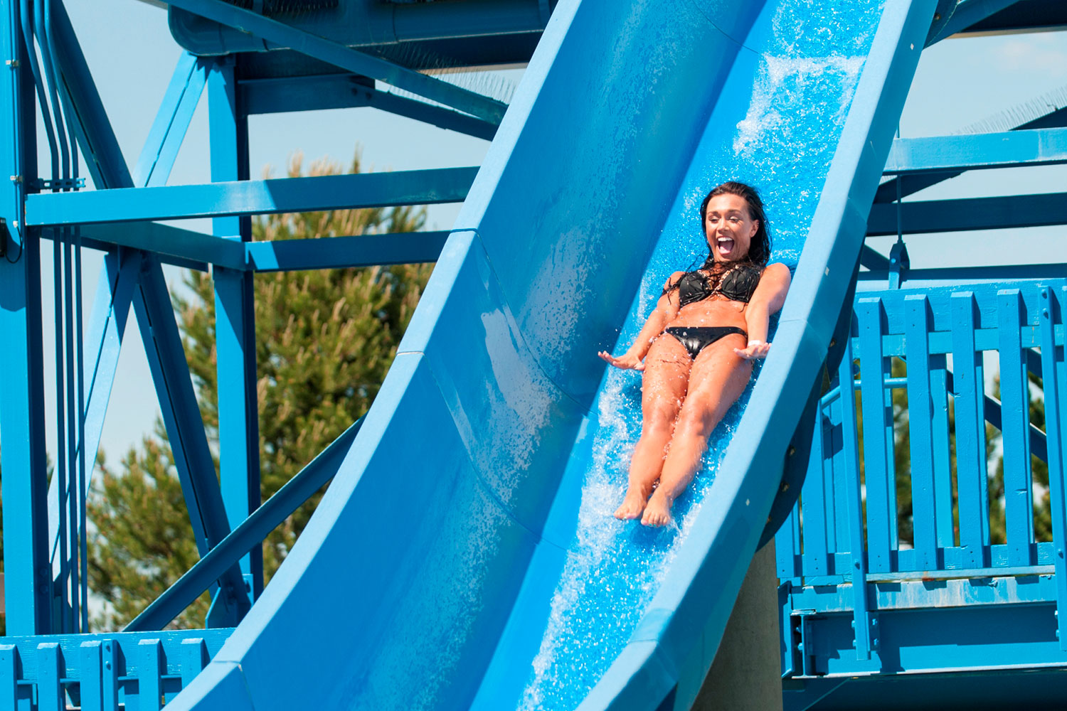 Girl Riding Drop Slide