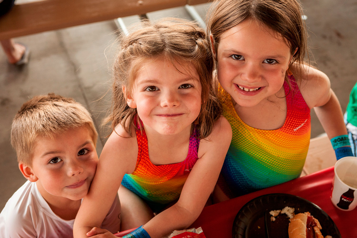 Two young girls and a boy eating