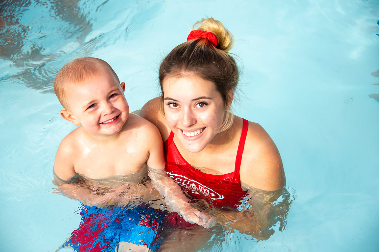 Swimming Instructor & Young Student