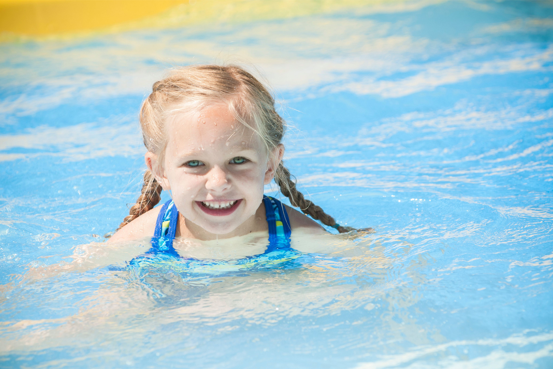 little blonde hiared girl swimming
