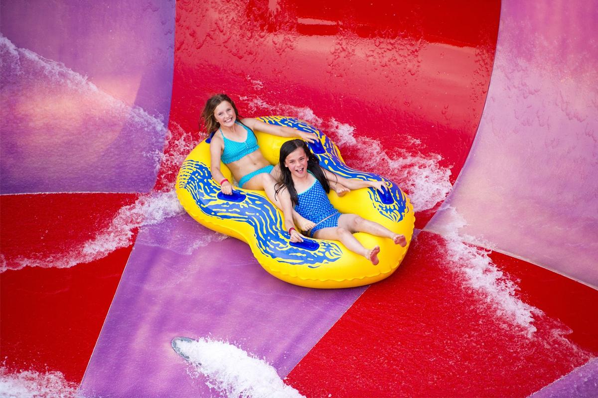 Two girls on viper slide